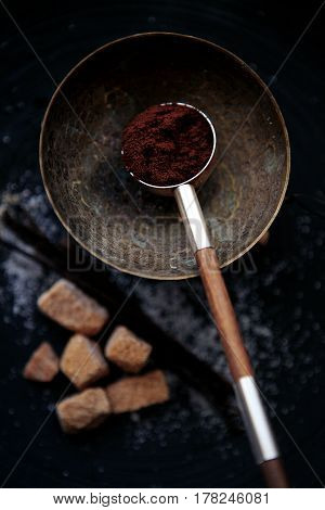 charming minimalistic still life with coffee spoon, brown sugar and vanilla pods