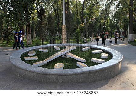 Ashgabat Turkmenistan - October 9 2014: Flower clock in the park. Ashkhabad. Turkmenistan in October 9 2014.