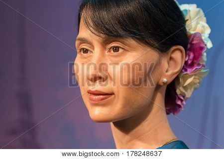 BANGKOK - OCT 21: A waxwork of Aung San Suu Kyi on display at Madame Tussauds on Oct 21 2012 in Bangkok Thailand. Madame Tussauds' newest branch hosts waxworks of numerous stars and celebrities