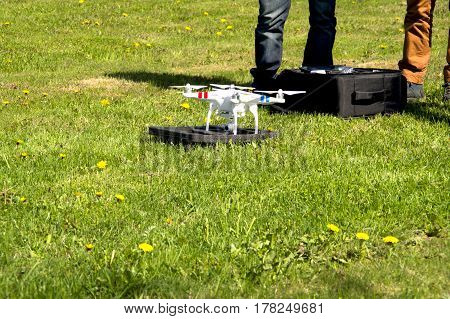 On the photo the operator prepares the drone for the flight