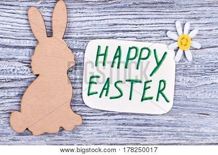 Wooden Easter rabbit. Easter holiday card. Wishing for happy Easter.