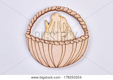 Rabbits in basket plywood cutout. Plywood art isolated. Buy Easter souvenirs.