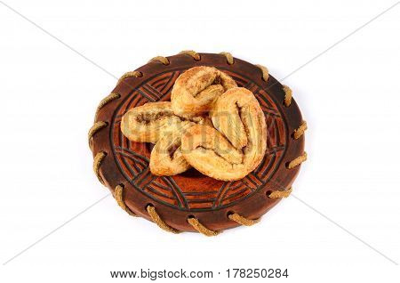 Cookies on a saucer on white background