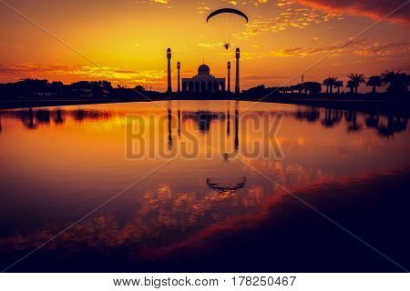 Silhouette of mosque at sunset with vintage filter tone.