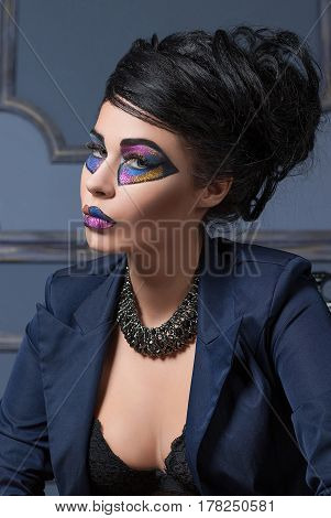 Beautiful brunette girl with bright make-up at a halloween party