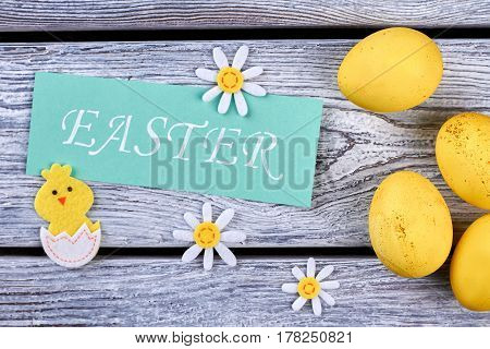 Group of yellow eggs. Easter card and felt decorations. Celebrating Easter holiday.