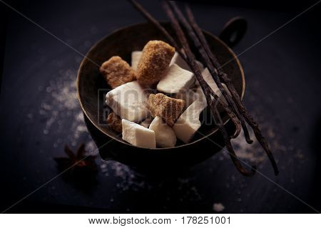charming minimalistic still life with brown sugar, white sugar, vanilla pods and star anise
