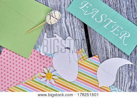 Papercut silhouettes and colorful sheets. Easter card and decor items. Easter creative ideas.