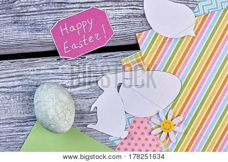 Papercut items and colorful papers. Happy Easter card and decor items. Easter decoration ideas.