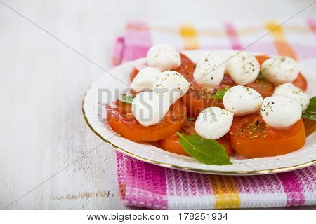 Caprese Salad On A Wooden Table.