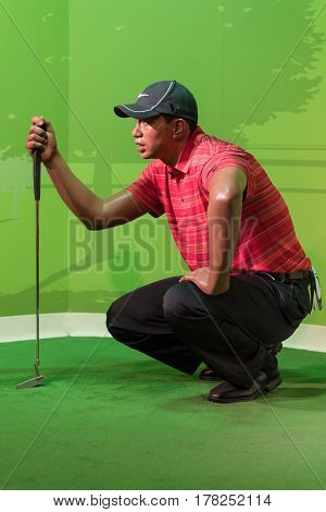 BANGKOK -JUL 22: A waxwork of Tiger Wood on display at Madame Tussauds on July 22, 2015 in Bangkok, Thailand. Madame Tussauds' newest branch hosts waxworks of numerous stars and celebrities