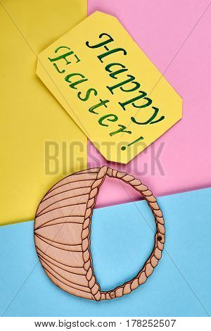 Easter card, plywood basket cutout. Bright paper background. Easter color combinations.