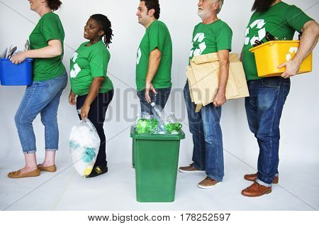 Ecology group of people smiling and cleaning
