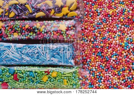 Colorful ball easter decoration candys, color background
