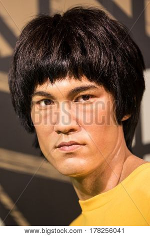 BANGKOK - JAN 29: A waxwork of Bruce Lee on display at Madame Tussauds on January 29 2016 in Bangkok Thailand. Madame Tussauds' newest branch hosts waxworks of numerous stars and celebrities