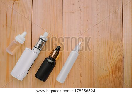 E-cigarette Or Vaping Device On Wooden Surface, Natural Light