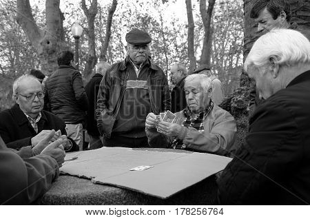 February 21, 2017, Porto, Portugal - old men playing cards in the streets near the Marques