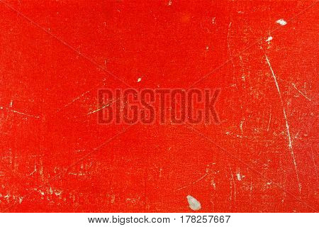 Old red paper texture with scratches and spots. Abstract background