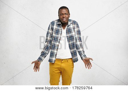 Cropped Shot Of Stylish Young Afro-american Man Shrugging Shoulders Gesturing With Hands As If Sayin