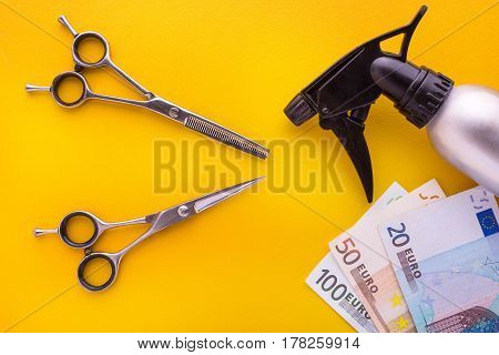 Hairdresser Set With Various Accessories And Euro Bill On Yellow Background