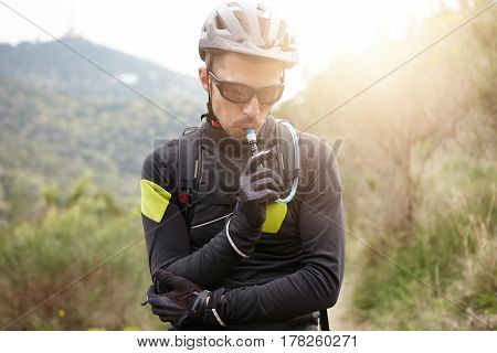 Sports, Extreme And Active Lifestyle. Attractive Young European Cyclist Wearing Protective Gear Hold