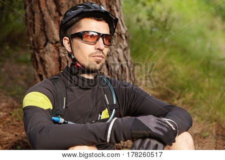 Few Minutes Of Rest. Close Up Shot Of Handsome Cyclist With Beard Relaxing After Workout, Sitting Un