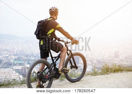 Sports, Healthy Lifestyle, Inspiration And Achievement Concept. Rear View Of Young Biker On Mountain