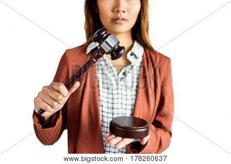 Businesswoman banging a law hammer on the gavel on white background