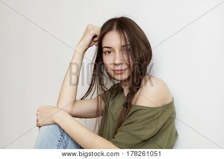 People, Youth And Happiness. Beautiful Girl Of Tender Age Sitting On Floor, Spending Leisure Time At