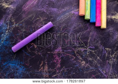 Colorful crayon and blackboard background, business concept