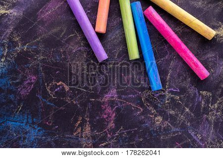 Different Chalks colorful on black background, bussines