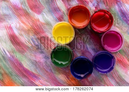 Abstract Flower Made Of Colorful Gouache Paint Containers Colored Background