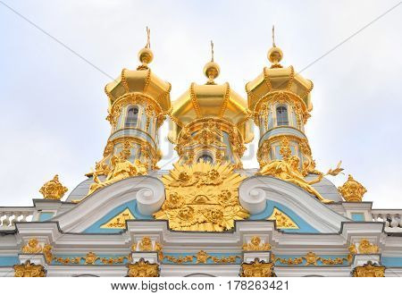 Golden cupolas of Catherine Palace church at cloud day suburb of St.Petersburg Russia.