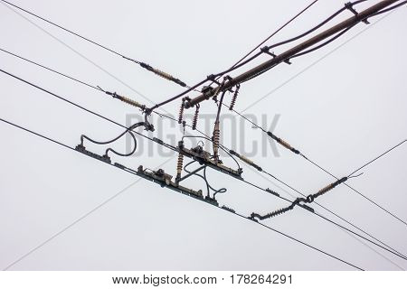 The wires for trolley buses on the gray background