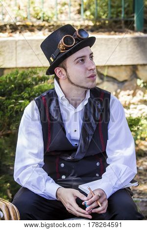 CAGLIARI, ITALY - May 29, 2016: Sunday at La Grande Jatte VIII Ed. At the Public Gardens - portrait of a young man in costume steampunk - Sardinia