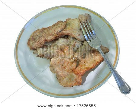 A close up of the pork chops on plate. Isolated on white.