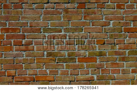 Old wall of red brick beaten by time