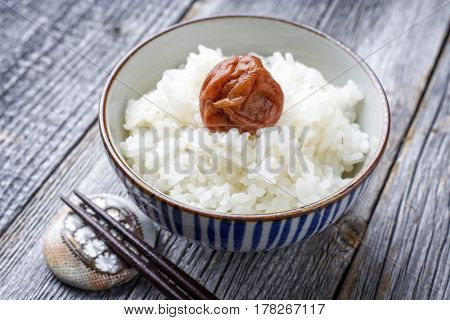 Traditional Japanese Koshihikari Rice with Umeboshi as close-up in a bowl