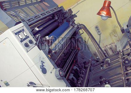 Mechanism parts of printing press. Close-up photo