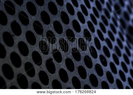 Pierced metal sheet textured background with space for your use