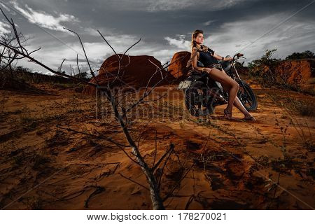 Steampunk Woman in top hat on Her Motorcycle