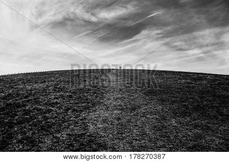 Couple on the hill top.White and black landscape.