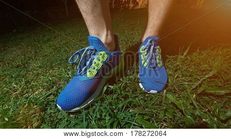 Man Standing On Running Blue Shoes