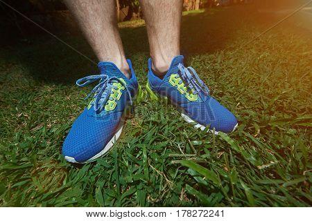 Runner Man Stand On Green Grass