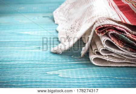 linen napkin on a wooden background. Kitchen Decor in Rustic Style.