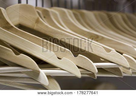 Plenty of White Wooden Coat Hangers Close up.