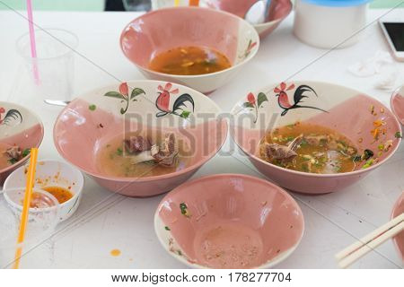 After eat Thai noodles on traditional rooster painted ceramic bowl chinese style from Thailand