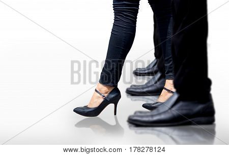 close up fit woman leg walking step up front of men in woman leader concept