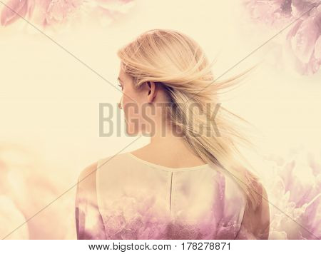 Young Woman On A Pink Floral Background