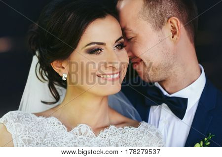 Groom Leans To A Perfect Bride's Face